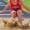 Effingham freshman Kylee Beard completes a jump of 14 feet, 11.75 inches during the long jump at the Apollo Conference Meet in Mattoon. Beard went on to finish fourth.