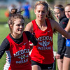 Neoga's Ellie Clark, left, takes the handoff from teammate Emmalyn Walk during the 4x800-meter relay at the National Trail Conference tournament in Altamont. Neoga's girls' team went on to finish first overall with 150 points.