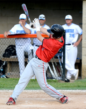Effingham's Ryan Sandifer follows through on an RBI single during the sixth inning of a Class 3A Mahomet-Seymour Regional game against Champaign Centennial. The hit proved to be the game-winner in a 5-2 Effingham victory.
