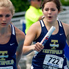 Teutopolis senior Cali Johnson, right, prepares to handoff to teammate Morgan Mette during the 4x200 relay finals at the IHSA State Track Meet in Charleston. The relay, also comprised of Lanae Koester and Julia Hardiek, finished fifth with a time of 1-minute, 48-seconds, a season best for the relay.