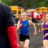 St. Anthony's Sarah Carr, middle, overtakes Casey-Westfield's Ellie Tutewiler just prior to crossing the finish line during the 4x800 relay in Newton. Carr helped the Lady Bulldogs earn second place with her come-from-behind performance in the final leg.