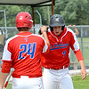 St. Anthony's Greg Utz (24) bumps fists with Drew Gibson (right) after Gibson hit a a triple and scored on an error on the play in a Class 1A Altamont Regional win over Neoga.