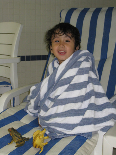 Jaden warming by the pool at the hilton in Richmond Hill