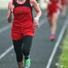 4-30-14<br /> Taylor track & field<br /> Cami Hansen in the 1600 M run<br /> Kelly Lafferty   Kokomo Tribune