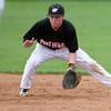 4-29-14<br /> Western vs. Taylor baseball<br /> Western's Austin Taylor scoops up the ball.<br /> Kelly Lafferty   Kokomo Tribune