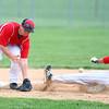 4-29-14<br /> Western vs. Taylor baseball<br /> Western's Evan Warden slides safely to third after Taylor's Nick Barnett misses the catch.<br /> Kelly Lafferty   Kokomo Tribune