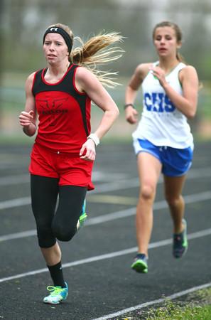 4-30-14<br /> Taylor track & field<br /> Cami Hansen in the 800 M run.<br /> Kelly Lafferty   Kokomo Tribune
