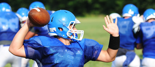 Globe/T. Rob Brown<br /> McAuley Catholic High School quarterback Collin Hughes prepares to launch the ball during a scrimmage Saturday morning, Aug. 24, 2013, at a Missouri Southern State University practice field.