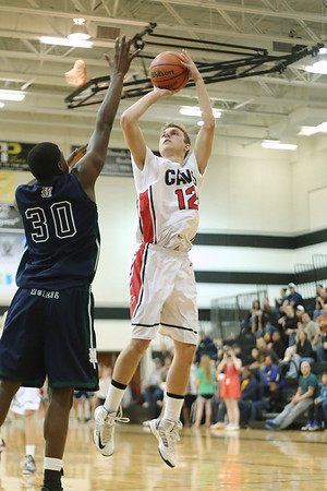 Lake Travis's Stefan Vidovic takes a shot against McNeil Tuesday at Vandegrift High School.