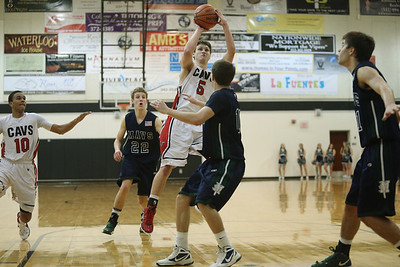 Lake Travis's Sean Steffan takes a shot against McNeil Tuesday at Vandegrift High School.