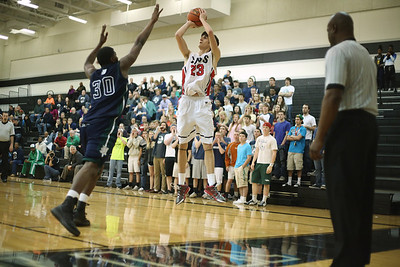 Lake Travis's Henry Castner takes a shot against McNeil Tuesday at Vandegrift High School.