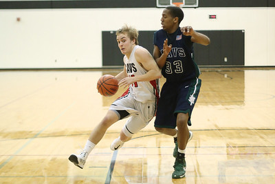 Lake Travis's Luke Hutton battles against a McNeil defender Tuesday at Vandegrift High School.