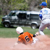"Meads Bryan Cummings, #6, slides into second base before Lyons Levi Campbell, #9,  can tag him out Saturday, April, 28th, 2012, Lyons.<br /> Photo By Derek Broussard<br /> For more photos visit  <a href=""http://www.dailycamera.com"">http://www.dailycamera.com</a>"