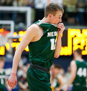 \Medina's Jackson Sartain walks off the floor during the fourth quarter of an 80-59 loss to Jackson in the Akron Regional semi-final game. (RON SCHWANE / GAZETTE)