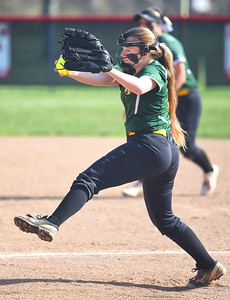 KRISTIN BAUER | GAZETTE Medina High School pitcher Catherine Stossel (9) pitches against Elyria on Wednesday afternoon, April 12.