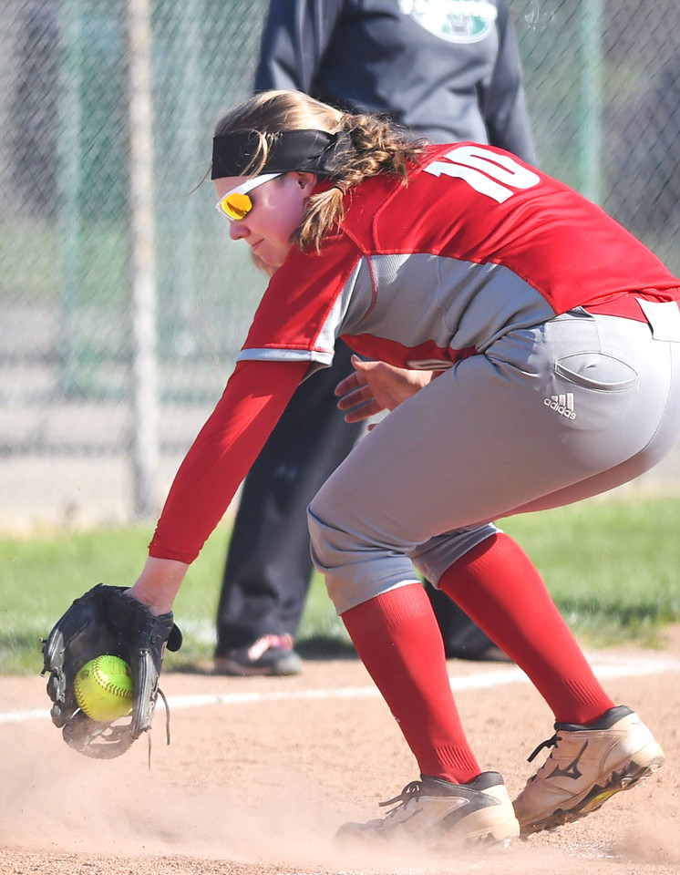 KRISTIN BAUER | GAZETTE Elyria High School third baseman Riley Zana (10) fields a ground ball hit during a game against Medina on Wednesday afternoon, April 12.