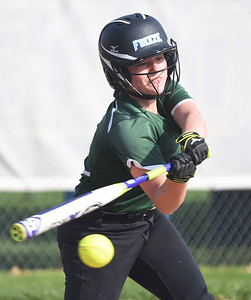 KRISTIN BAUER | GAZETTE Medina High School's Claire Rambo (4) bats against Elyria High School on Wednesday afternoon, April 12.