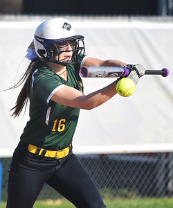 KRISTIN BAUER | GAZETTE Medina High School's Rachael Solomon (16) bunts during a game against Elyria High School on Wednesday afternoon, April 12.