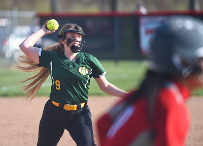 KRISTIN BAUER | GAZETTE Medina High School pitcher Catherine Stossel (9) throws out Elyria High School's Dierra Hammons (17) at first on Wednesday afternoon, April 12.