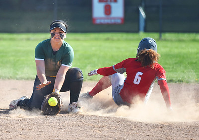 KRISTIN BAUER | GAZETTE Elyria High School's Keerah Williams (6) slides safely into second base as Medina High School's Caitlyn Rhodes (17) fails to secure the ball and lay the tag in time on Wednesday afternoon, April 12.