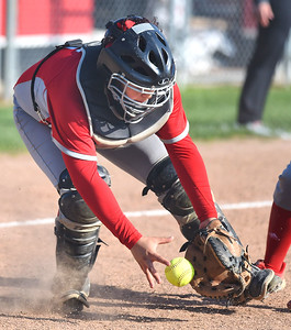 KRISTIN BAUER | GAZETTE Elyria High School catcher Maycee Godbolt (15) fields a ground ball and fires to first for an out against Medina on Wednesday afternoon, April 12.