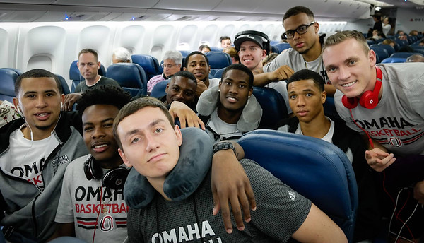 Ready for takeoff: the team on the plane before its flight from Atlanta to Milan Front Row (L-R): Marcus Tyus, Devin Patterson, Jake White. Second Row: Tra-Deon Hollins, Randy Reed II, Zach Jackson. Back Row: Devin Newsome, Alex Allbery, Tim Smallwood, Kyler Erickson Photo by Bonnie Ryan