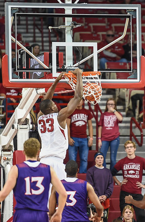 Arkansas Razorbacks forward Moses Kingsley (33) with a dunk during a basketball game between Arkansas and Northwestern State on December 1, 2015.    (Alan Jamison, Nate Allen Sports Service)