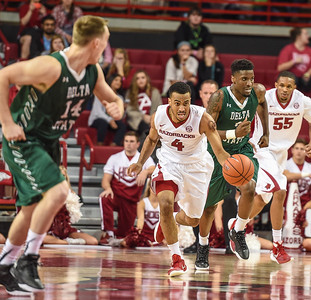 Jabril Durham (4) takes the ball downcourt during a basketball game between Arkansas and Delta State on November 10, 2015.    (Alan Jamison, Nate Allen Sports Service)