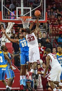 Arkansas Razorbacks forward Moses Kingsley (33) shoots during a basketball game between Arkansas and Southern University on November 13, 2015.    (Alan Jamison, Nate Allen Sports Service)