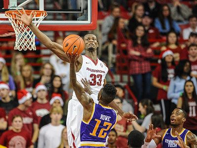 Arkansas Razorbacks forward Moses Kingsley (33) with a block during a basketball game between Arkansas and Tennessee Tech on December 12, 2015.    (Alan Jamison, Nate Allen Sports Service)