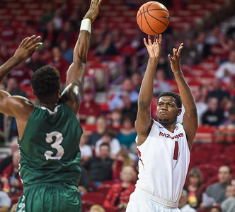 Trey Thompson (1) shoots during a basketball game between Arkansas and Delta State on November 10, 2015.    (Alan Jamison, Nate Allen Sports Service)
