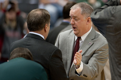 Dec 4, 2011; East Lansing, MI, USA; Michigan State Spartans head coach Tom Izzo (left) greets Nebraska-Omaha Mavericks head coach Derrin Hansen (right) at the Breslin Center. Mandatory Credit: Tim Fuller