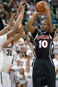 Dec 4, 2011; East Lansing, MI, USA; Nebraska-Omaha Mavericks guard C.J. Carter (10) takes a jump shot over the Michigan State Spartans defenders during the first half at the Breslin Center. Mandatory Credit: Tim Fuller