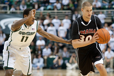 Dec 4, 2011; East Lansing, MI, USA; Nebraska-Omaha Mavericks guard Mitch Albers (30) gets  past Michigan State Spartans guard Keith Appling (11) during the first half at the Breslin Center. Mandatory Credit: Tim Fuller