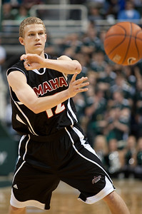 Dec 4, 2011; East Lansing, MI, USA; Nebraska-Omaha Mavericks guard Caleb Steffensmeier (12) passes the ball during the first half against the Michigan State Spartans at the Breslin Center. Mandatory Credit: Tim Fuller