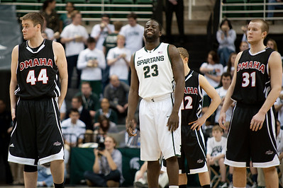 Dec 4, 2011; East Lansing, MI, USA; Nebraska-Omaha Mavericks center John Karhoff (44) and forward Alex Welhouse (31) along with Michigan State Spartans forward Draymond Green (23) during the first half at the Breslin Center. Mandatory Credit: Tim Fuller