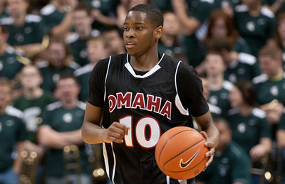 Dec 4, 2011; East Lansing, MI, USA; Nebraska-Omaha Mavericks guard C.J. Carter (10) dribbles the ball up court against the Michigan State Spartans during the first half at the Breslin Center. Mandatory Credit: Tim Fuller