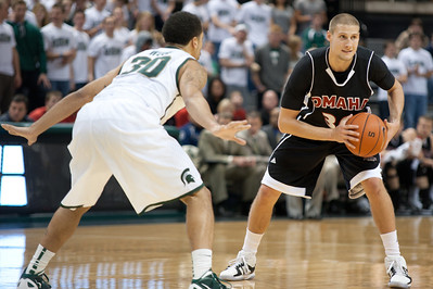Dec 4, 2011; East Lansing, MI, USA; Nebraska-Omaha Mavericks guard Mitch Albers (30) looks to get around Michigan State Spartans guard Brandon Wood (30) during the first half at the Breslin Center. Mandatory Credit: Tim Fuller
