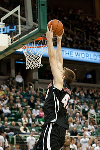 Dec 4, 2011; East Lansing, MI, USA; Nebraska-Omaha Mavericks forward Matt Hagerbaumer (42) slam dunks the ball during the first half against the Michigan State Spartans at the Breslin Center. Mandatory Credit: Tim Fuller