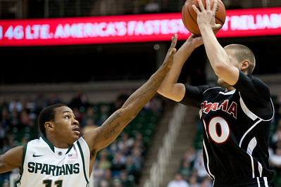Dec 4, 2011; East Lansing, MI, USA; Michigan State Spartans guard Keith Appling (left) attempts to block Nebraska-Omaha Mavericks guard Mitch Albers (30) during the first half at the Breslin Center. Mandatory Credit: Tim Fuller