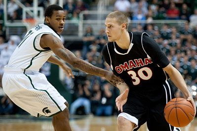 Dec 4, 2011; East Lansing, MI, USA; Nebraska-Omaha Mavericks guard Mitch Albers (30) dribbles past Michigan State Spartans guard Keith Appling (11) during the first half at the Breslin Center. Mandatory Credit: Tim Fuller
