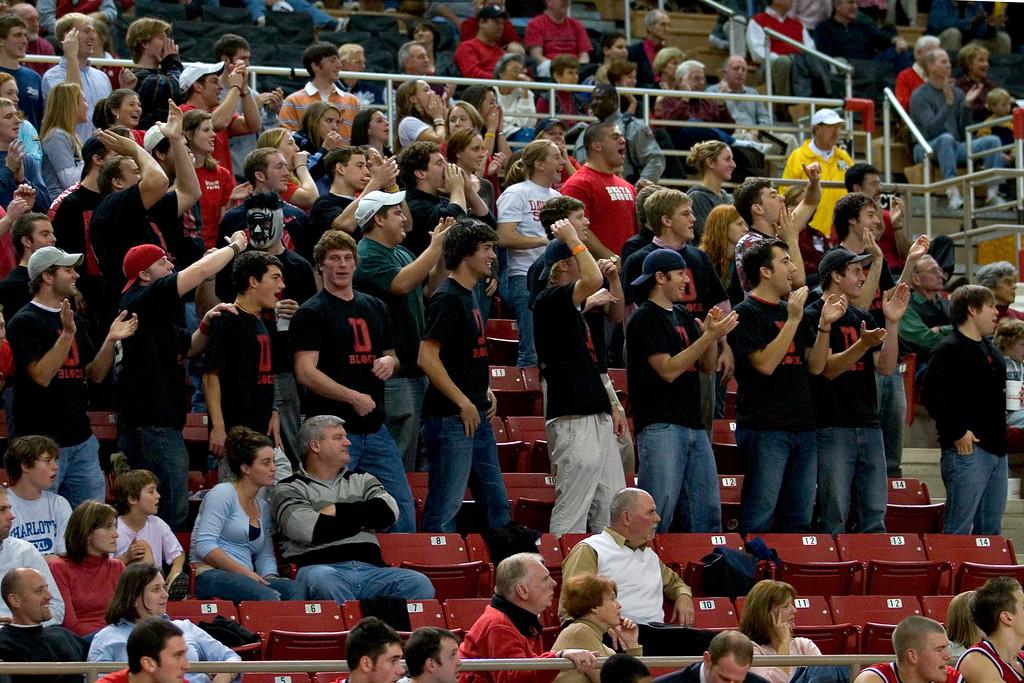 davidson college wildcats versus catholic university men's basketball ncaa sports photos pics photography