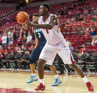 Arkansas Razorbacks forward Trey Thompson (1) passes the ball during a basketball game between the Arkansas Razorbacks and the Southwestern Oklahoma State Bulldogs in Bud Walton Arena on November 5, 2015.   Arkansas won 103-58.   (Alan Jamison, Nate Allen Sports Service)