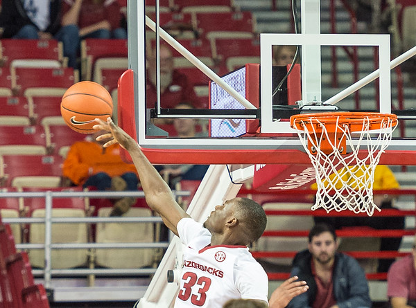 Arkansas Razorbacks forward Moses Kingsley (33) had two blocks during a basketball game between the Arkansas Razorbacks and the Southwestern Oklahoma State Bulldogs in Bud Walton Arena on November 5, 2015.   Arkansas won 103-58.   (Alan Jamison, Nate Allen Sports Service)