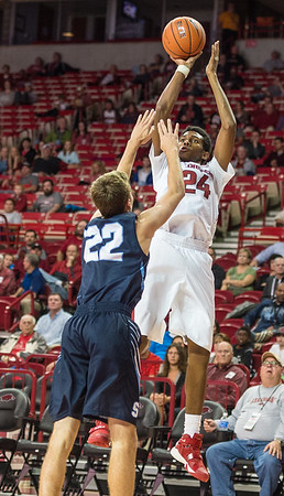 Arkansas Razorbacks guard Jimmy Whitt (24) with a shot during a basketball game between the Arkansas Razorbacks and the Southwestern Oklahoma State Bulldogs in Bud Walton Arena on November 5, 2015.   Arkansas won 103-58.   (Alan Jamison, Nate Allen Sports Service)