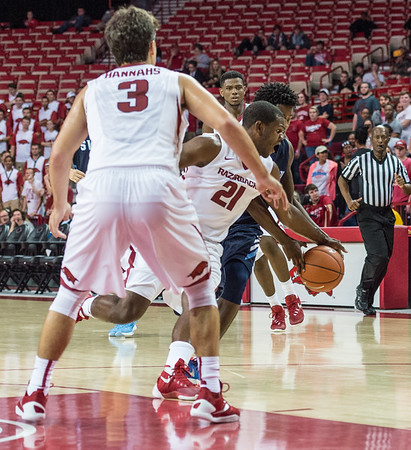 Arkansas Razorbacks guard Manuale Watkins (21) had three steals during a basketball game between the Arkansas Razorbacks and the Southwestern Oklahoma State Bulldogs in Bud Walton Arena on November 5, 2015.   Arkansas won 103-58.   (Alan Jamison, Nate Allen Sports Service)