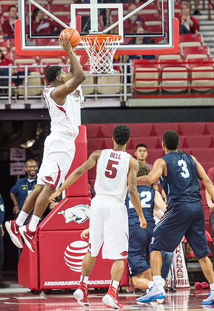 Arkansas Razorbacks forward Trey Thompson (1) goes up for a stuff during a basketball game between the Arkansas Razorbacks and the Southwestern Oklahoma State Bulldogs in Bud Walton Arena on November 5, 2015.   Arkansas won 103-58.   (Alan Jamison, Nate Allen Sports Service)