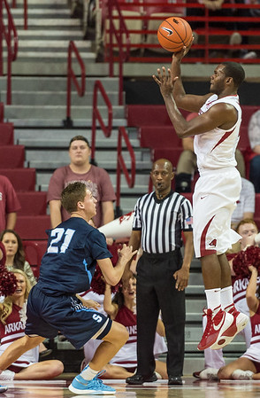Arkansas Razorbacks guard Manuale Watkins (21) shoots during a basketball game between the Arkansas Razorbacks and the Southwestern Oklahoma State Bulldogs in Bud Walton Arena on November 5, 2015.   Arkansas won 103-58.   (Alan Jamison, Nate Allen Sports Service)