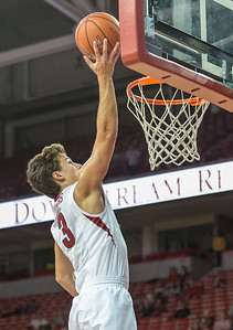 Arkansas Razorbacks guard Dusty Hannahs (3) with a layup during a basketball game between the Arkansas Razorbacks and the Southwestern Oklahoma State Bulldogs in Bud Walton Arena on November 5, 2015.   Arkansas won 103-58.   (Alan Jamison, Nate Allen Sports Service)