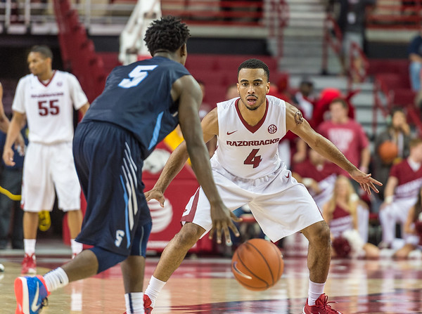 Arkansas Razorbacks guard Jabril Durham (4) defends during a basketball game between the Arkansas Razorbacks and the Southwestern Oklahoma State Bulldogs in Bud Walton Arena on November 5, 2015.   Arkansas won 103-58.   (Alan Jamison, Nate Allen Sports Service)